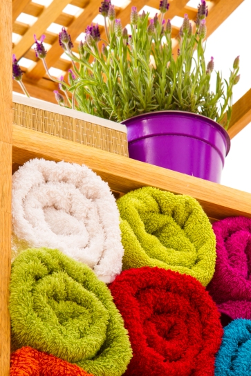 Rolling towels instead of folding increases shelf space.