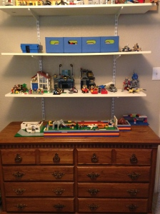 Lego dresser for storage and building surface. Shelving above for display.