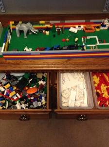 "Keep legos off the floor by re-purposing a ""low-boy"" dresser."